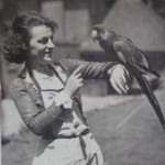 Gracie and her parrot in the garden of 'Tower'