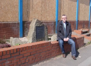 Sitting by the stone commemorating Gracie's birthplace, even the memorial car wash is boarded up now!